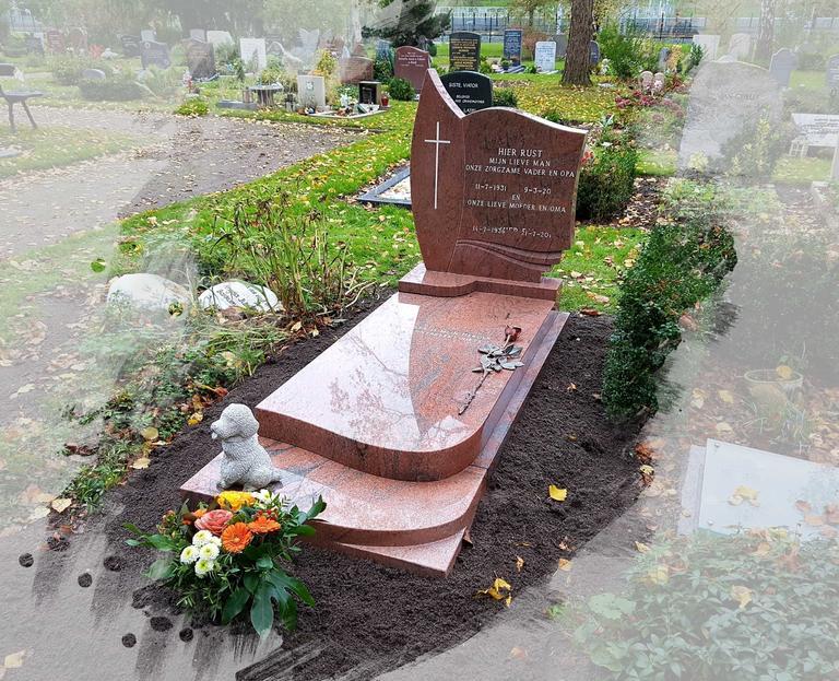 Grafsteen met grote bronzen roos