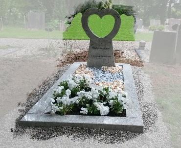 Grafsteen met open hart van graniet te Geldermalsen