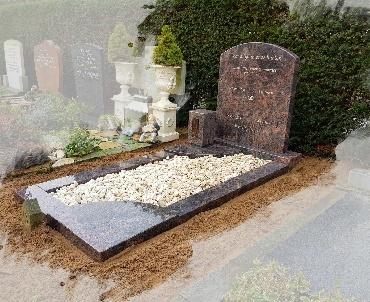 grafsteen met urn te Zwammerdam