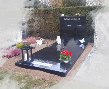 grafsteen met accessoires