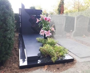 grafsteen met mooie golf